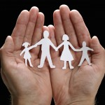 Papercut family in hands representing insurance protection from the personal insurance options available