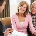 Senior couple discussing Personal Insurance Quotes with a life insurance advisor
